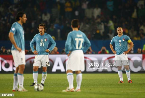 Luca Toni Andrea Pirlo Giuseppe Rossi and Fabio Cannavaro of Italy look disappointment after conceding the third goal during the FIFA Confederations...