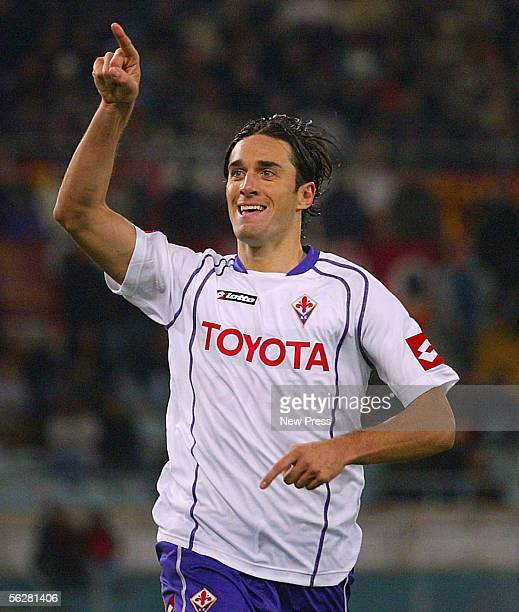Luca Toni celebrates scoring in action during the Serie A match between AS Roma and Fiorentina at the Stadio Olimpico on November 27 2005 in Rome...