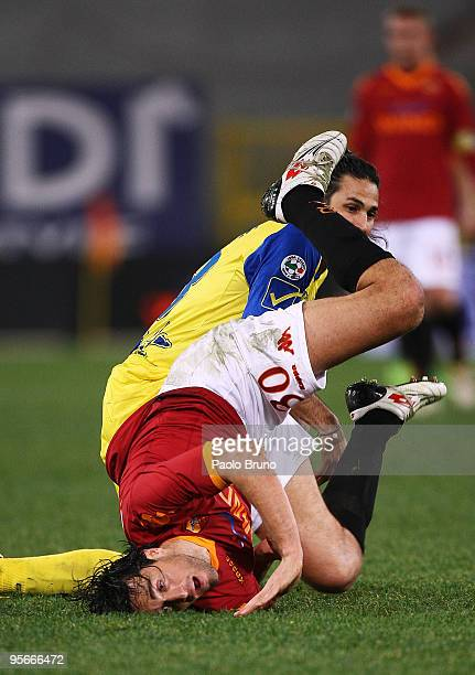 Luca Toni of AS Roma hits the ground during the Serie A match between Roma and Chievo at Stadio Olimpico on January 9 2010 in Rome Italy