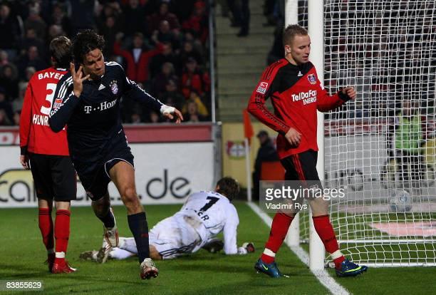 Luca Toni of Bayern celebrates after scoring the 01 goal against Rene Adler of Leverkusen during the Bundesliga match between Bayer 04 Leverkusen and...