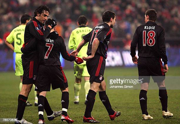 Luca Toni of Bayern celebrates with his teammates Franck Ribery Mark van Bommel and Miroslav Klose after scoring 20 during the UEFA Cup Group F match...