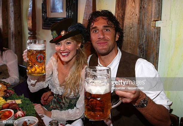 Luca Toni of Bayern Muenchen and his girlfriend Marta Cecchetto attend the Kaefer beer tent during the Oktoberfest beer festival on October 5 2008 in...