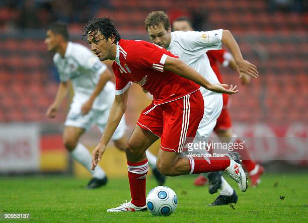 Luca Toni of Bayern Muenchen battles for the ball with Stefan Jarosch of Regensburg during the Third Liga match between Bayern Muenchen II and SSV...