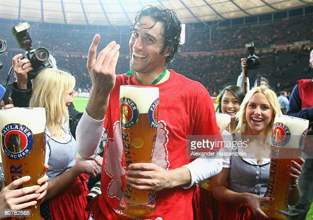 Luca Toni of Bayern Munich enjoys a glas of beer after winning the German Cup Final against Borussia Dortmund at the Olympic stadium on April 19 2008...