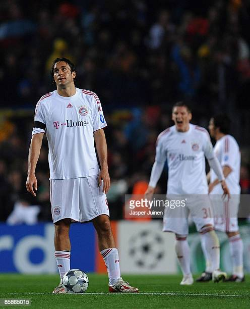 Luca Toni of Bayern Munich looks dejected after conceding a goal during the UEFA Champions League quarter final first leg match between FC Barcelona...