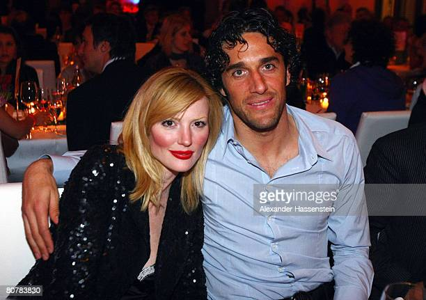Luca Toni of Bayern Munich poses with his girlfriend Marta Cecchetto during the Bayern Munich champions party after the DFB Cup Final match between...