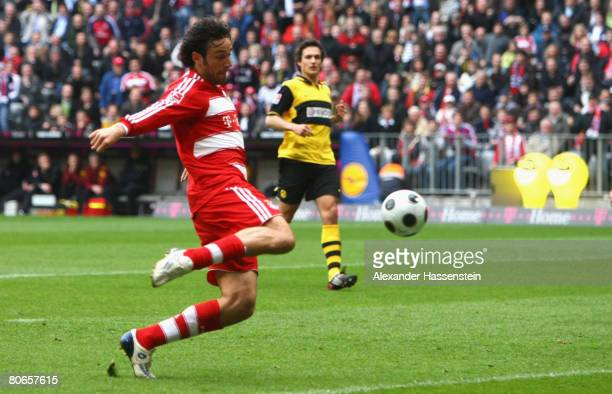 Luca Toni of Bayern Munich scores the 4th goal during the Bundesliga match between Bayern Munich and Borussia Dortmund at the Allianz Arena on April...