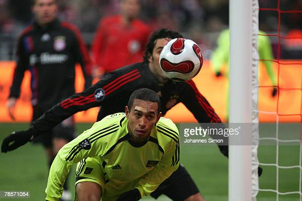 Luca Toni of Bayern scores 30 against Aurelio of Saloniki during the UEFA Cup Group F match between Bayern Munich and Aris Saloniki at the Allianz...
