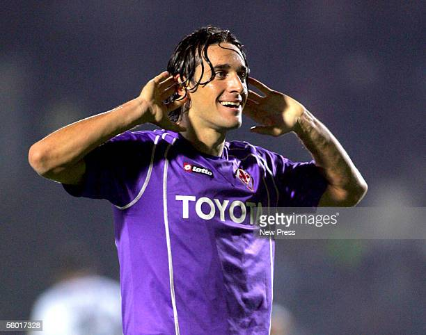 Luca Toni of Fiorentina celebrates his goal during the Serie A match between Siena and Fiorentina at the Stadio Artemio Franchi on October 26 2005 in...