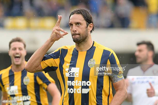 Luca Toni of Helas Verona celebrates after scoring his opening goal from the penalthy spot during the Serie A match between Hellas Verona FC and...