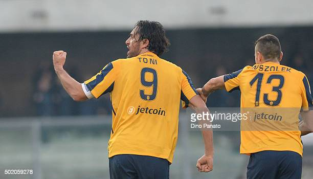 Luca Toni of Hellas Verona celebrates with his team mate's after scoring his team's first goal during the Serie A match between Hellas Verona FC and...