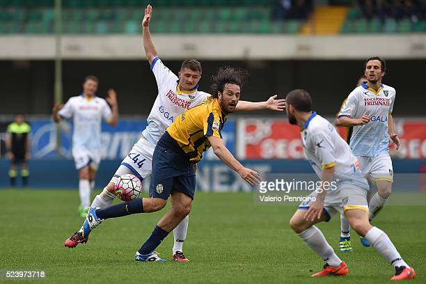 Luca Toni of Hellas Verona FC is tackled by Vasyl Pryyma of Frosinone Calcio during the Serie A match between Hellas Verona FC and Frosinone Calcio...