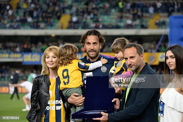Luca Toni of Hellas Verona with his wife Marta Cecchetto and children receives a plaque for his last game from president of Verona Maurizio Setti...