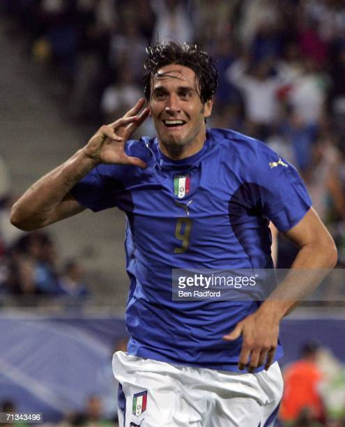 Luca Toni of Italy celebrates after scoring his team's second goal during the FIFA World Cup Germany 2006 Quarterfinal match between Italy and...