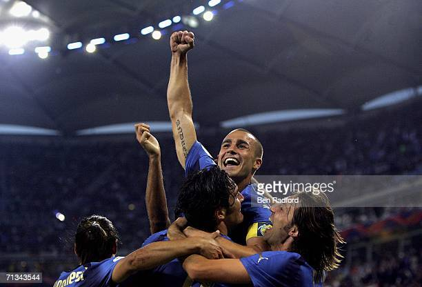 Luca Toni of Italy celebrates with teammate Fabio Cannavaro and Andrea Pirlo after scoring his team's second goal during the FIFA World Cup Germany...