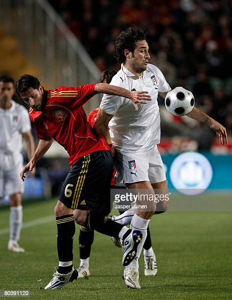 Luca Toni of Italy duels for the ball with Joan Capdevila of Spain during the international friendly match between Spain and Italy at the Martinez...