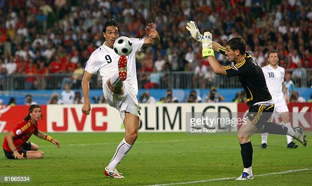 Luca Toni of Italy stretches for the ball as goalkeeper Iker Casillas of Spain runs out during the UEFA EURO 2008 Quarter Final match between Spain...
