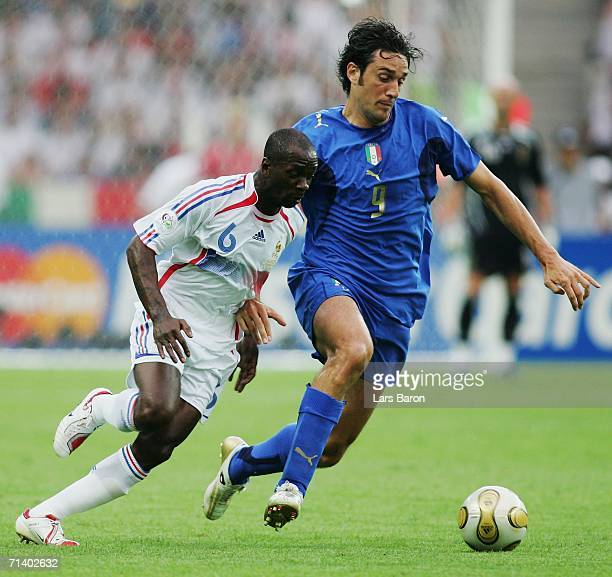 Luca Toni of Italy tussles for posession with Claude Makelele of France during the FIFA World Cup Germany 2006 Final match between Italy and France...