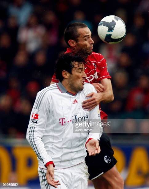 Luca Toni of Muenchen and Pavel Krmas of Freiburg jump for a header during the Bundesliga match between SC Freiburg and Bayern Muenchen at the...