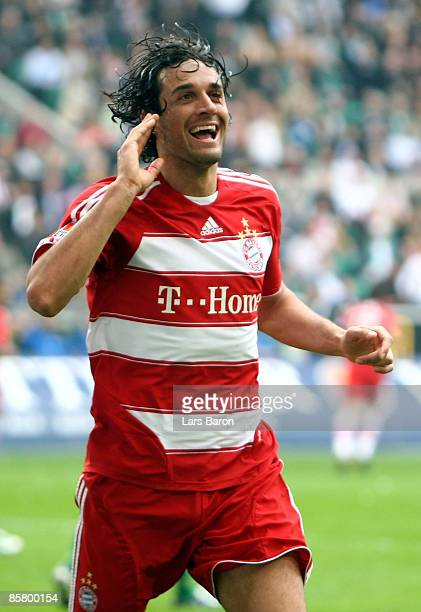 Luca Toni of Muenchen celebrates scoring his team's first goal during the Bundesliga match between VfL Wolfsburg and FC Bayern Muenchen at the...