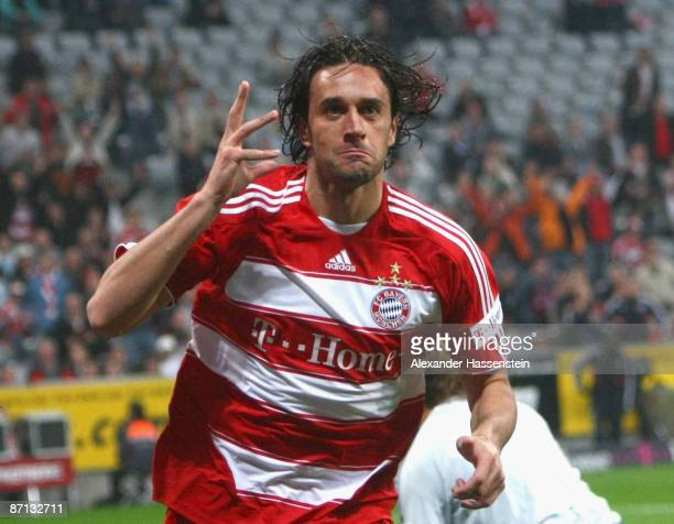 Luca Toni of Muenchen celebrates scoring the opening goal during the Bundesliga match between FC Bayern Muenchen and Bayer 04 Leverkusen at Allianz...