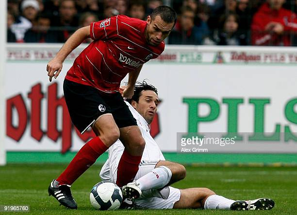 Luca Toni of Muenchen is challenged by Pavel Krmas of Freiburg during the Bundesliga match between SC Freiburg and Bayern Muenchen at the Badenova...