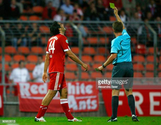 Luca Toni of Muenchen receives a yellow card by referee Dominik Nowak during the Third Liga match between Bayern Muenchen II and SSV Jahn Regensburg...