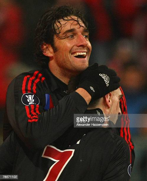 Luca Toni of Munich celebrates scoring the 3rd goal with his team mateFranck Ribery during the UEFA Cup Group F match between Bayern Munich and Aris...