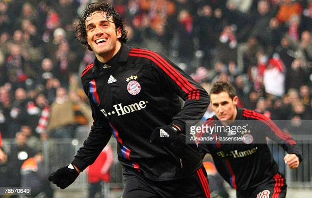 Luca Toni of Munich celebrates scoring the second goal with his team mate Miroslav Klose during the UEFA Cup Group F match between Bayern Munich and...