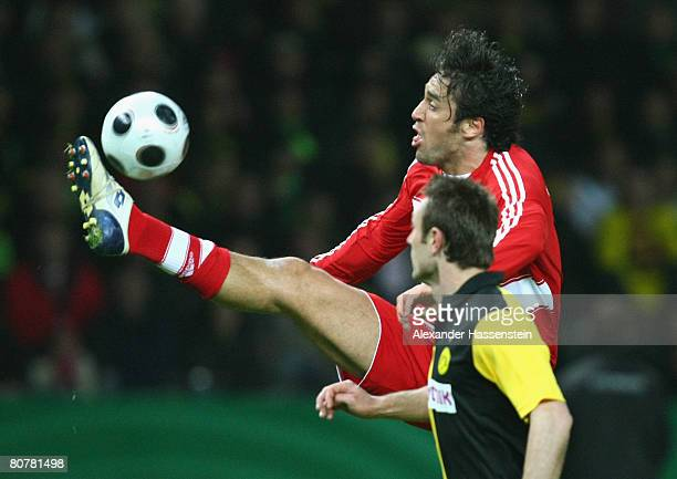 Luca Toni of Munich fight for the ball with Robert Kovac of Dortmund during the DFB Cup Final match between Borussia Dortmund and FC Bayern Munich at...