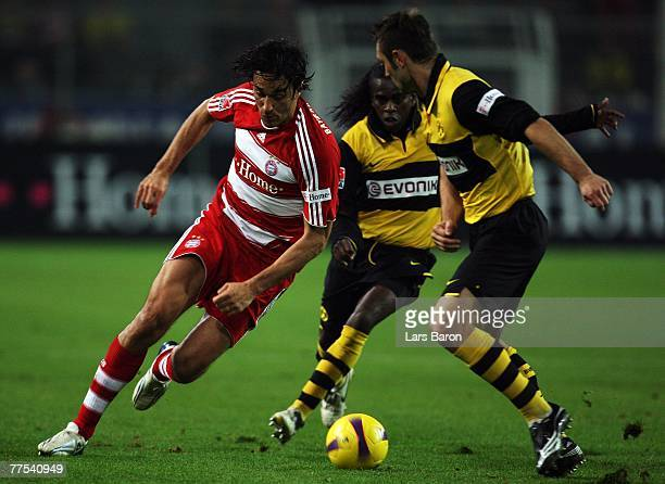 Luca Toni of Munich in action with Tinga and Robert Kovac of Dortmund during the Bundesliga match between Borussia Dortmund and Bayern Munich at the...