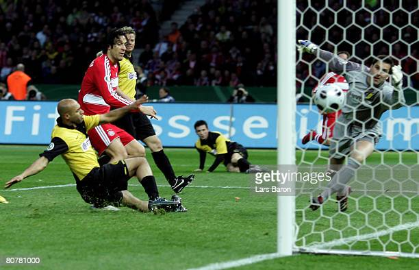 Luca Toni of Munich scores the first goal during the DFB Cup Final match between Borussia Dortmund and Bayern Munich at the Olympic stadium on April...