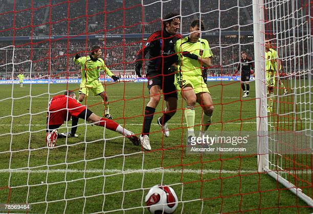 Luca Toni of Munich scores the first goal during the UEFA Cup Group F match between Bayern Munich and Aris Saloniki at the Allianz Arena on December...