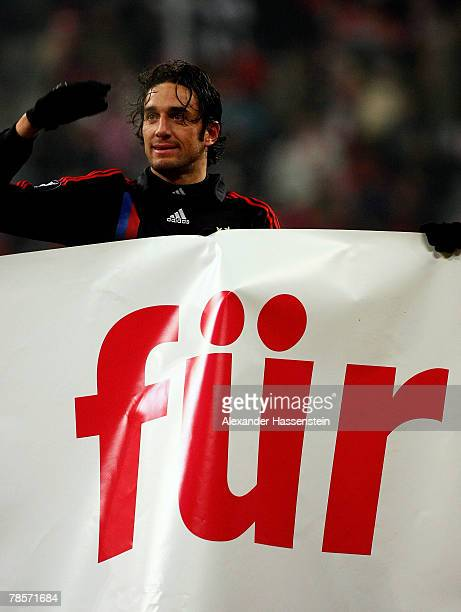 Luca Toni of Munich shows sympathy for the Munich supporters after the UEFA Cup Group F match between Bayern Munich and Aris Saloniki at the Allianz...