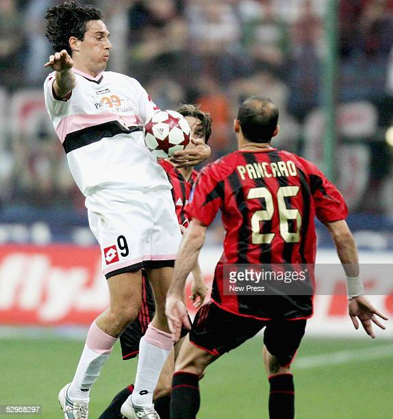 Luca Toni of Palermo challenges Giuseppe Pancaro of AC Milan during the Serie A game between AC Milan and Palermo at the Guisseppe Meazza San Siro...