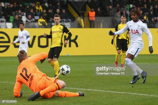 Luca Unbehaun of Dortmund saves a shot of Kazaiah Sterling of Tottenham during the UEFA Youth League match between Borussia Dortmund and Tottenham...