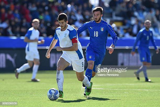 Luca Valzania of Italy B is challenged by Bryan Cristante of Italy U21 during the friendly match between Italy U21 and Italy B on February 10 2016 in...