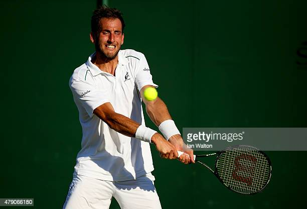 Luca Vanni of Italy in action in his Gentlemens Singles first round match against James Ward of Great Britain during day two of the Wimbledon Lawn...