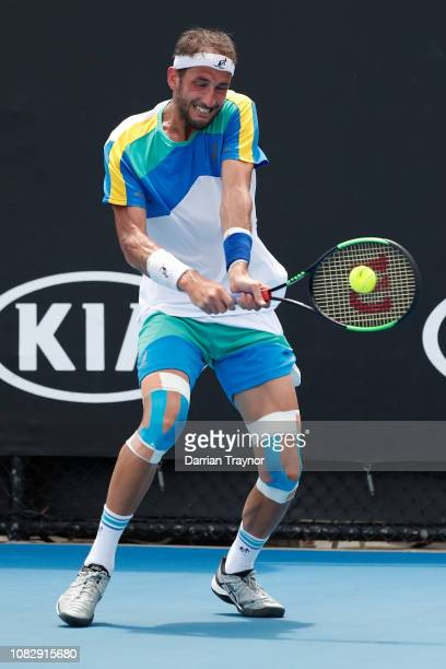Luca Vanni of Italy plays a backhand in his first round match against Pablo Carreno Busta of Spain during day two of the 2019 Australian Open at...