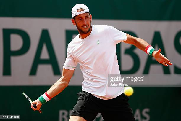 Luca Vanni of Italy plays a forehand during his men's singles match against Bernard Tomic of Australia on day two of the 2015 French Open at Roland...