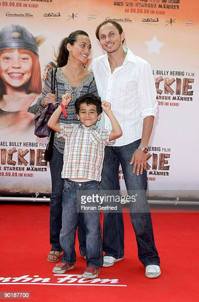 Luca Verhoeven and wife Stephanie and son Patrice attend the premiere of 'Vicky The Viking' at Mathaeser cinema on August 30 2009 in Munich Germany