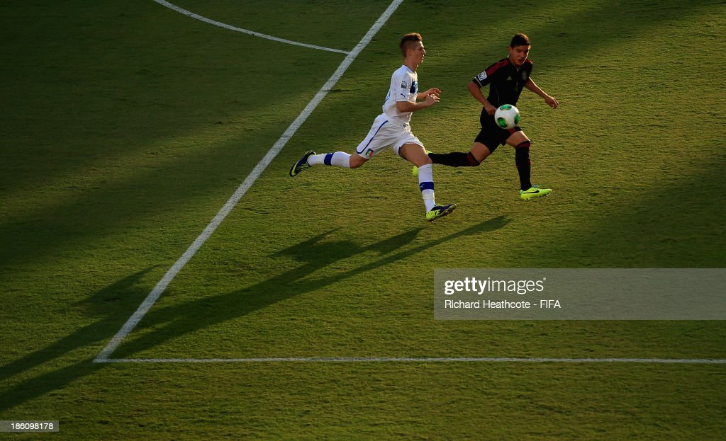 Luca Vido of Italy chases down Pedro Teran of Mexico during the FIFA U-17 World Cup UAE 2013 Round of 16 match between Italy and Mexico at the Mohamed Bin Zayed Stadium on October 28, 2013 in Abu Dhabi, United Arab Emirates.