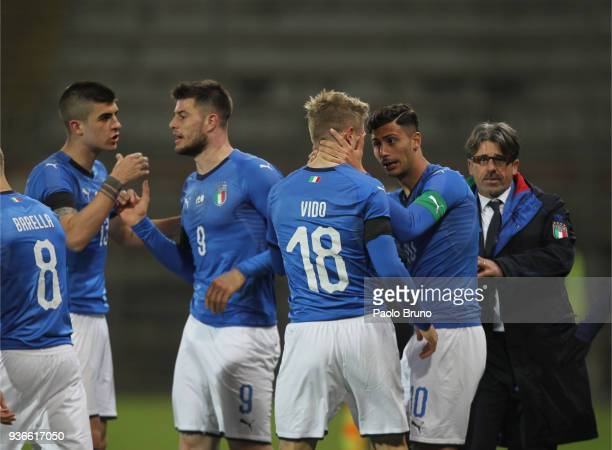 Luca Vido with his teammates of Italy U21 celebrates after scoring the team's first goal during the international friendly match between Italy U21...