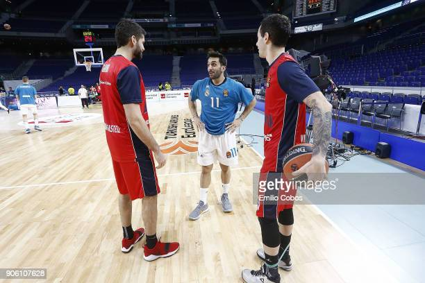 Luca Vildoza #3 and Patricio Garino #29 of Baskonia Vitoria Gasteiz chats with Facundo Campazzo #11 of Real Madrid before tip off the 2017/2018...