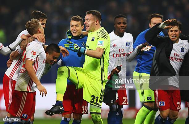 Luca Waldschmidt and Christian Mathenia of Hamburg celebrate their win at the end of the Bundesliga match between Hamburger SV and FC Augsburg at...