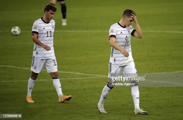 Luca Waldschmidt and Matthias Ginter of Germany gesture after losing the UEFA Nations League Group stage League A Group 4 soccer match against Spain...