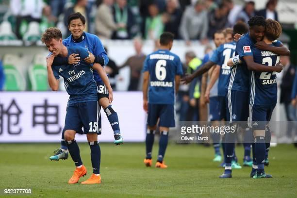 Luca Waldschmidt and Tatsuya Ito of Hamburg celebrate after the Bundesliga match between VfL Wolfsburg and Hamburger SV at Volkswagen Arena on April...