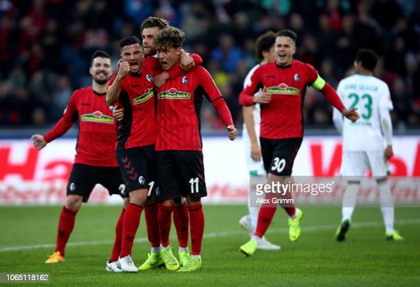 Luca Waldschmidt of Freiburg celebrate with his team mates after he scores the opening goal by penalty during the Bundesliga match between SportClub...