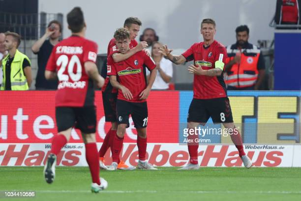Luca Waldschmidt of Freiburg celebrates his team's third goal with team mates during the Bundesliga match between SportClub Freiburg and VfB...