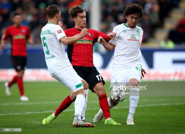 Luca Waldschmidt of Freiburg challenges Ludwig Augustinsson and Milos Velijkovic of Bremen during the Bundesliga match between SportClub Freiburg and...